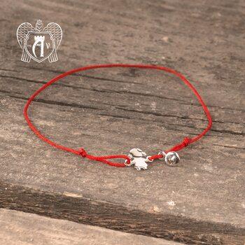 Браслет из серебра на красной нитке